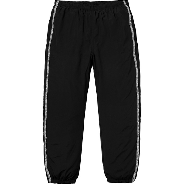 Tonal Taping Track Pant - Water resistant nylon taslan with mesh lining and woven logo taping. On seam hand pockets and single back zip pocket. Bottom gussets with zipper closure, elastic cuffs and waistband with interior drawcord and interior hanging key pocket.