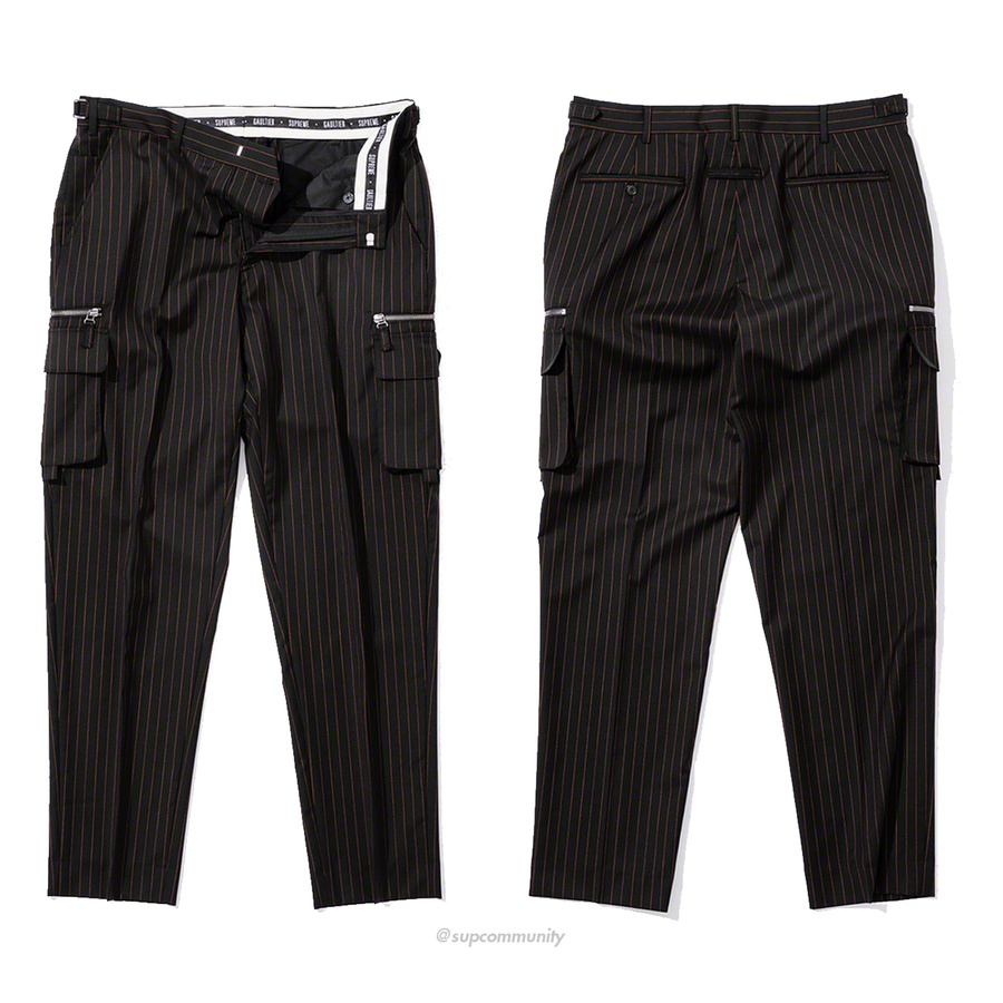 Supreme®/Jean Paul Gaultier® Pinstripe Cargo Suit Pant - Loro Piana® merino wool half lined trousers with hook closure and zip fly. Slanted front pockets with single coin pocket, back welt pockets and interior waistband curtain with woven logo taping. Zip and cargo patch pockets at thighs with size adjuster...