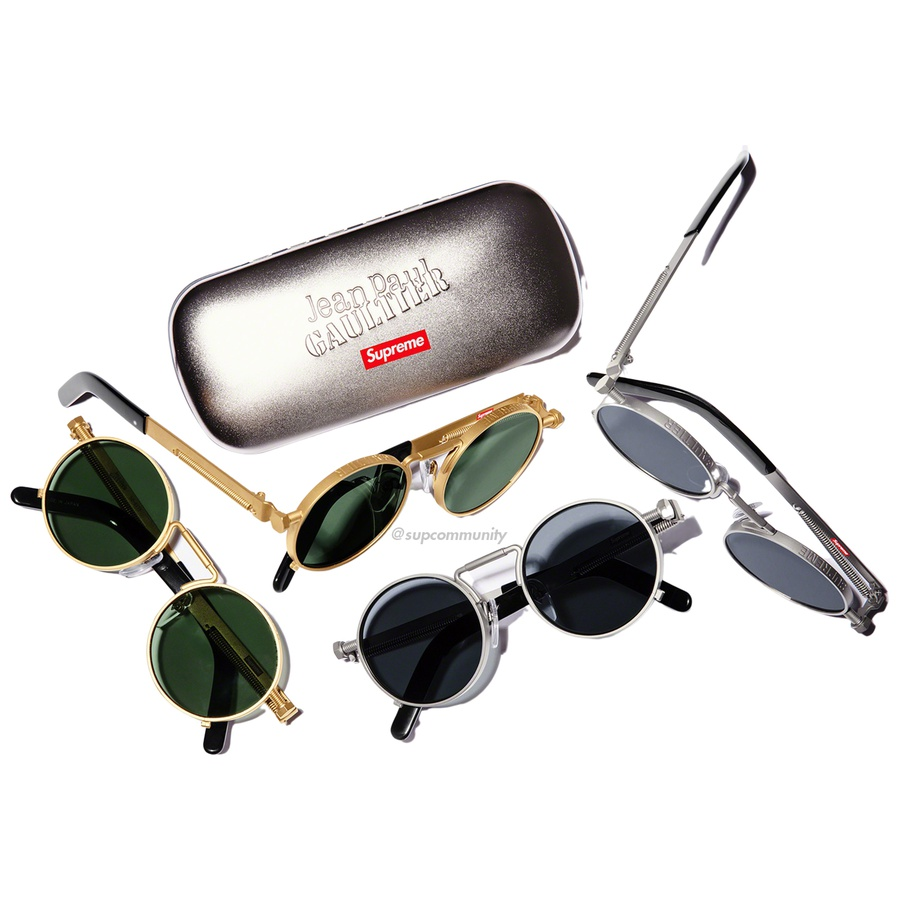 Supreme®/Jean Paul Gaultier® Sunglasses - Handmade metal frames with anti-reflective coated glass lenses. Engraved logos at top of frames with spring detail at temple. Made in Japan exclusively for Supreme®/Jean Paul Gaultier®.