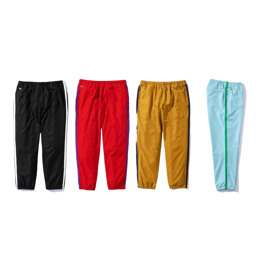 Supreme®/LACOSTE Track Pant - Water repellant poly with cotton jersey and taffeta lining. On seam hand pockets and back zip pocket. Bottom gussets with zip closure, elastic cuffs and waistband with interior drawcord. Contrast piping, embroidered logo patch at waistband and embroid...