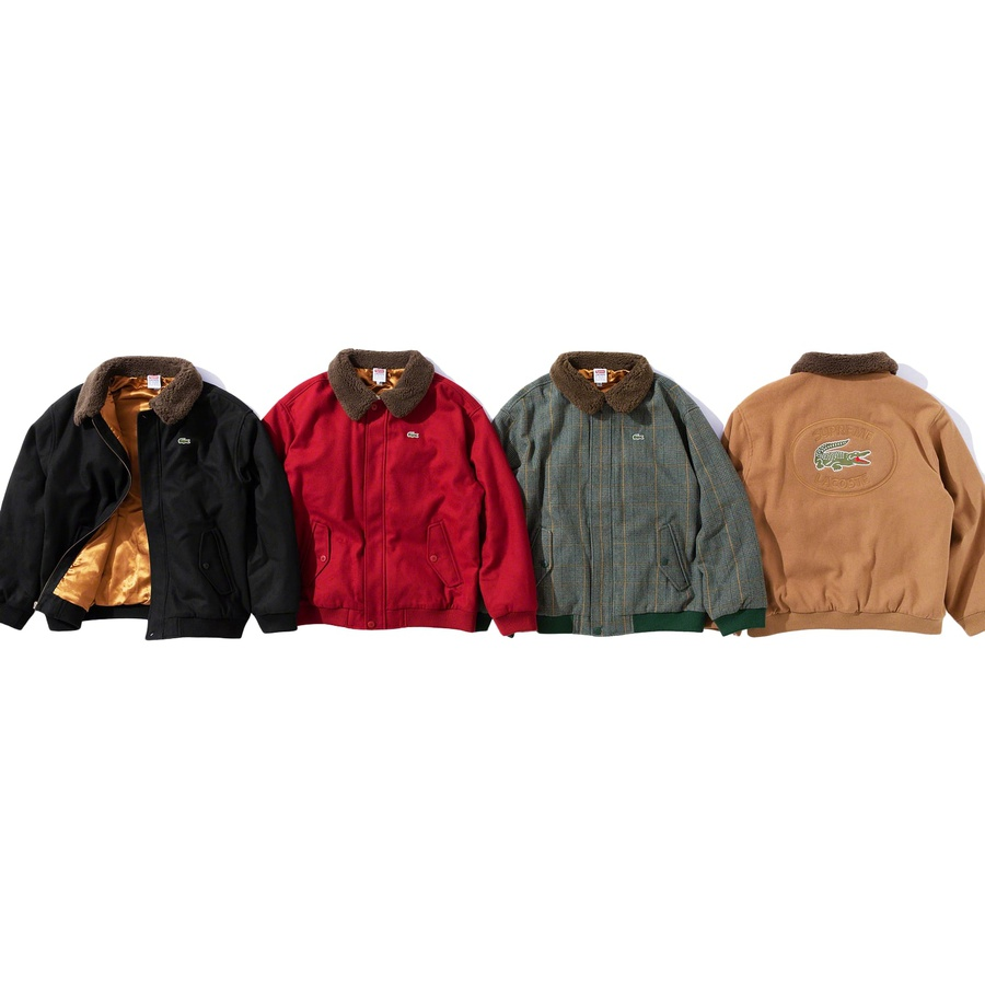 Supreme®/LACOSTE Wool Bomber Jacket - 11 oz. melton wool with satin lining, fill and full zip closure with storm placket. Double welt hand pockets at lower front with button flap closure and interior chest pocket. Faux fur collar with rib cuffs and hem. Embroidered patch on back. Made exc...