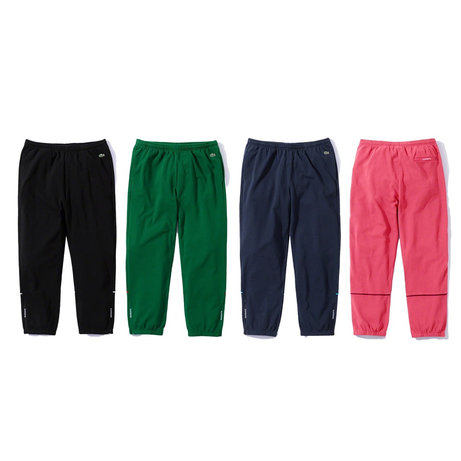 Supreme®/LACOSTE Pique Pant - All cotton pique fleece with on seam hand pockets and back zip pocket. Bottom gussets with zip closure, elastic cuffs and waistband with interior drawcord. Jacquard logo zipper tape at gussets and back pocket. Contrast piping at lower leg and embroide...