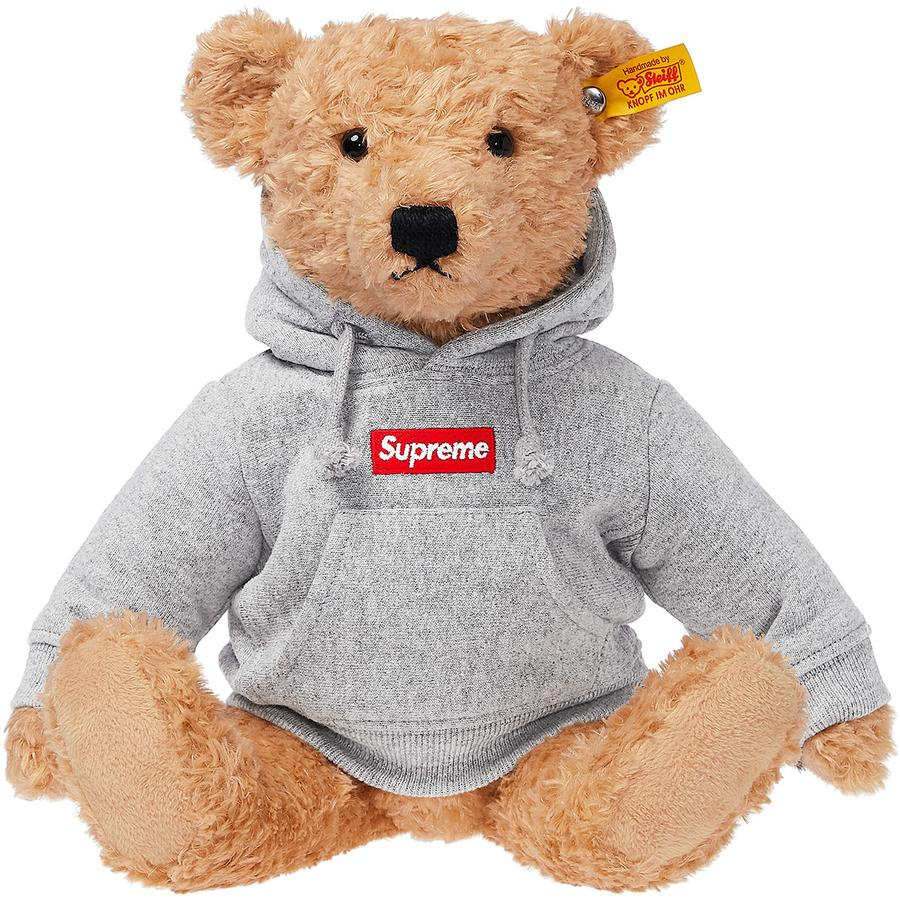 Supreme®/Steiff® Bear - Steiff® Elmar bear with synthetic fill. Cotton fleece hooded sweatshirt with embroidered logo on chest. Stainless steel button in ear with Steiff® logo label. Made exclusively for Supreme.
