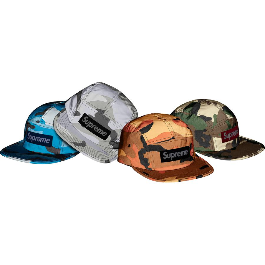 Reflective Camo Camp Cap - Reflective printed poly Supreme camp cap with reflective webbing strap closure.
