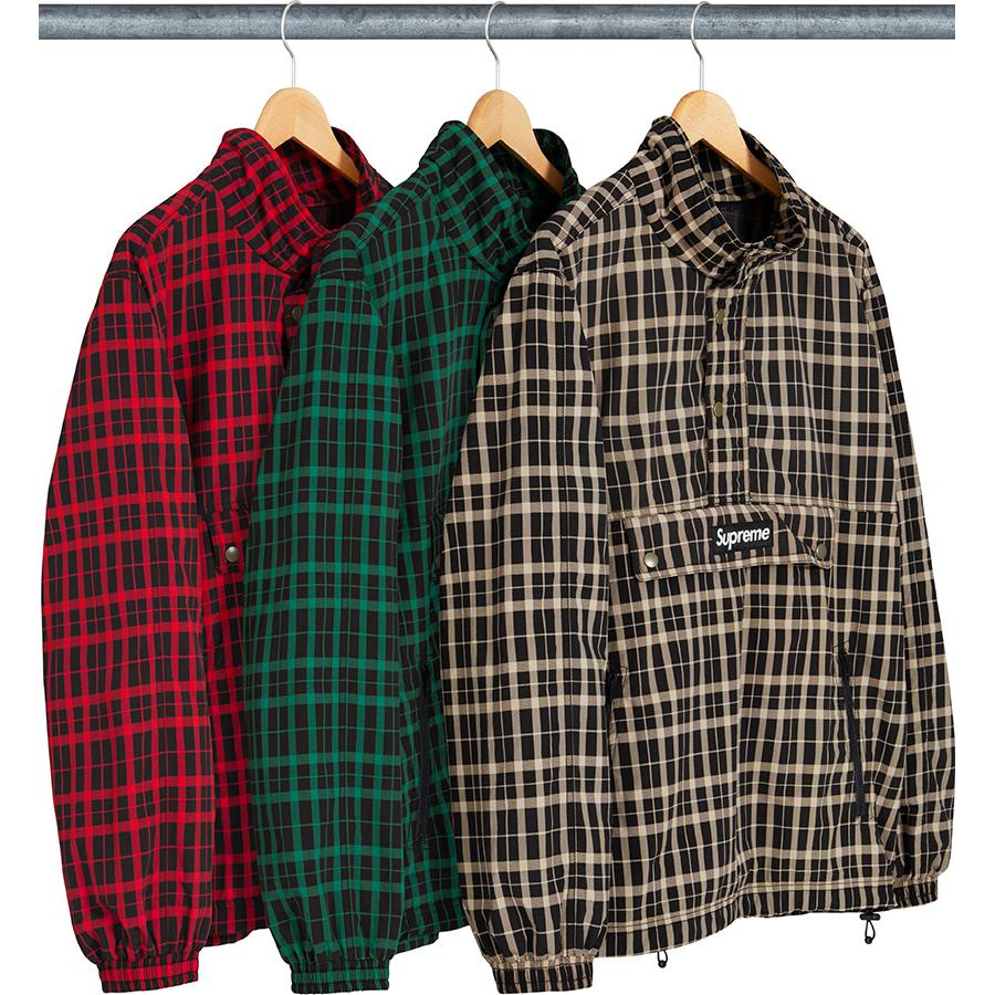 Nylon Plaid Pullover - Water resistant nylon taslan with mesh lining and half zip closure with snap placket. Pouch pocket with zip closure and snap flap at chest and zip hand pockets at lower front. Elastic cuffs and hem with drawcord. Woven logo patch on chest.