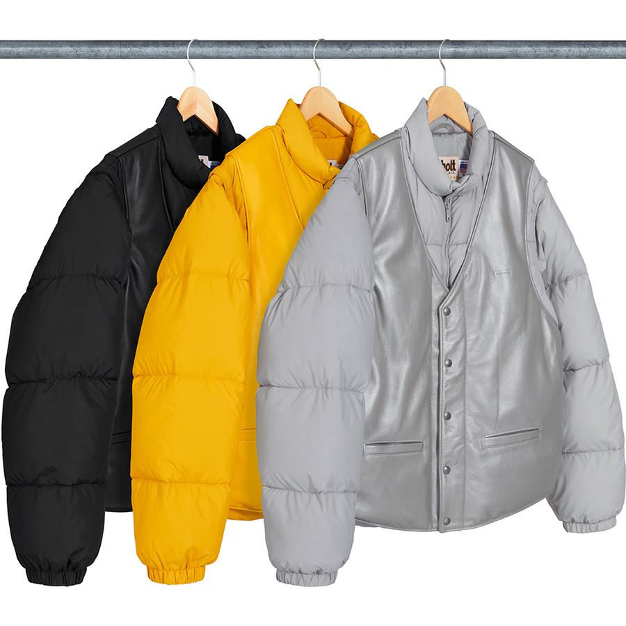 Supreme®/Schott® Down Leather Vest Puffy Jacket - Custom fit nylon with down fill and cowhide leather full front vest and back yoke. Full zip and snap front closures with two-way zip off sleeves. Welt hand pockets at lower front with side pocket openings and interior chest pocket. Debossed logo on ch...