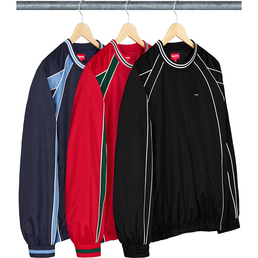 Piping Warm Up Pullover - Water resistant poly with cotton blend jersey lining. Hand pockets and side zip openings at lower front. Stripe rib collar with elastic cuffs and hem. Contrast piping and panels with embroidered logo patch on chest.