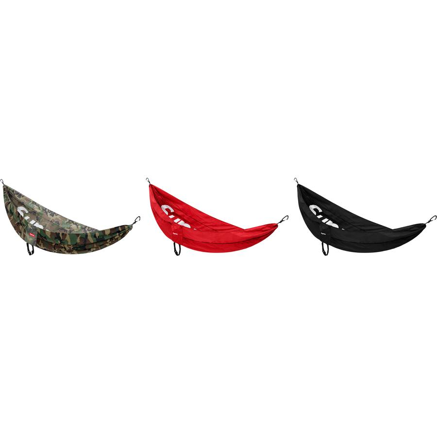 "Supreme®/ENO® DoubleNest® Hammock - 70-denier nylon taffeta with triple stitched seams and aluminum wiregate carabiners. Printed logo on base. Maximum capacity 400lbs. Fits two people. Packs into compression sack. 9'4"" x 6'2""."
