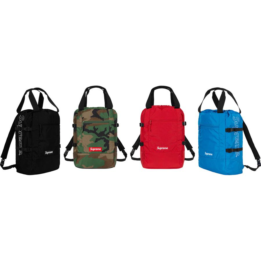 Tote Backpack - Lightweight Cordura® nylon ripstop with embossed logo lining. Main compartment with drawcord closure, front zip pocket and back pocket with velcro closure. Tote and backpack straps at top with compression straps at sides. Packable construction. 18L.