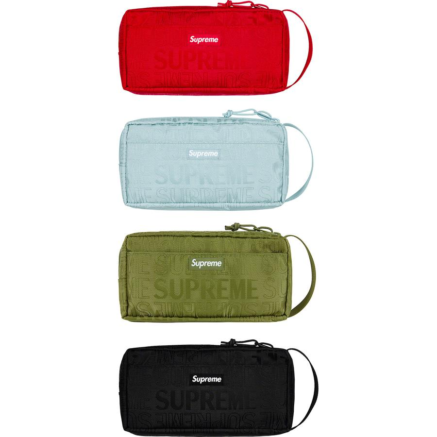 Organizer Pouch - Cordura® nylon with jacquard logo pattern and embossed logo lining. Main zip compartment with internal mesh zip pocket and elastic utility band. Front pocket with velcro closure and woven logo label. 1L.