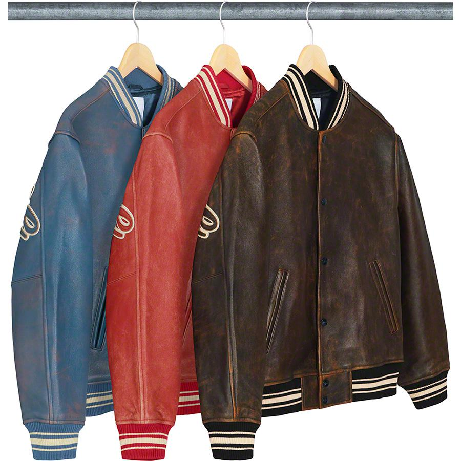 Leather Varsity Jacket - Lambskin leather with satin lining and snap front closure. Double welt hand pockets at lower front and interior chest pocket. Stripe rib collar, cuffs and hem. Two-layer leather appliqué logo on back.