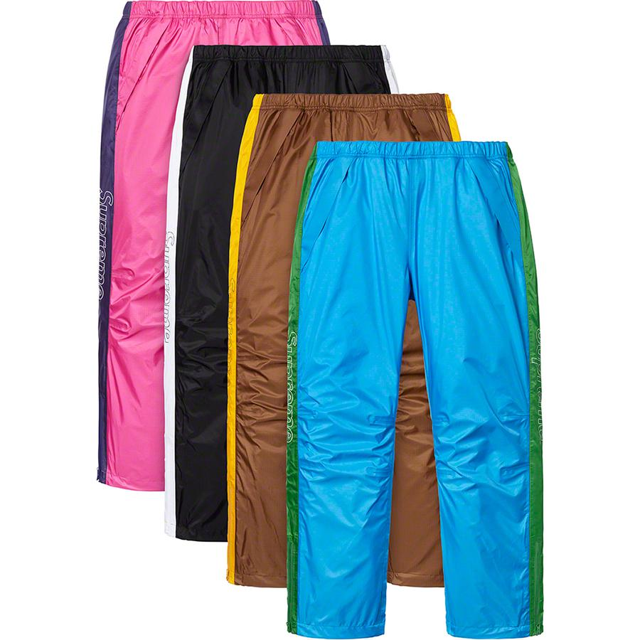 Taped Seam Pant - Waterproof, breathable nylon 3-layer shell with tricot backing and taped seams. Zip hand pockets and back zip pocket. Bottom gussets with zip closure and interior shockcord at waistband and cuffs. Contrast panels with printed logos at sides.